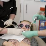 Girl visiting the dentist